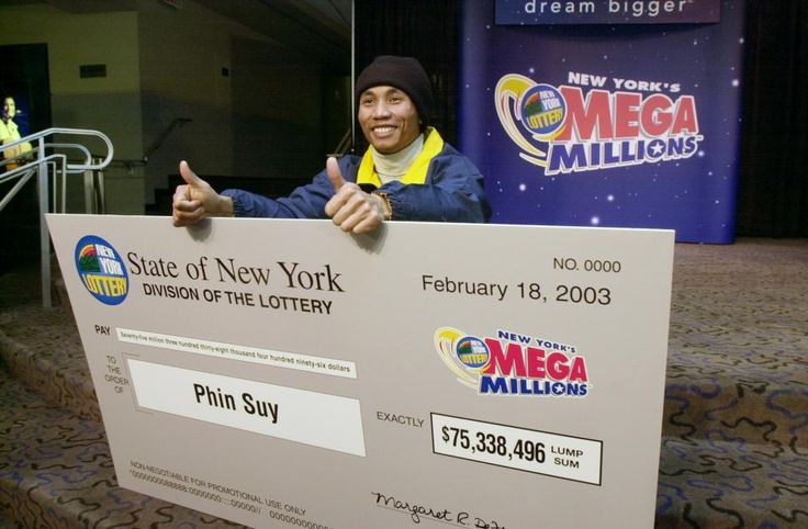 Phin Suy gives two thumbs up at Madison Square Garden where he was named winner of $128 million -- the largest single jackpot in New York Lottery history, at the time -- on Feb. 9, 2003. January 13, 2016.
