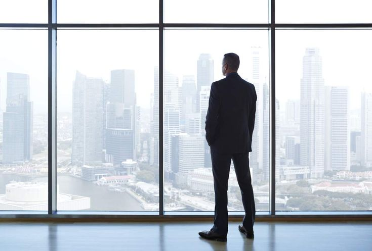 businessman-looking-out-window