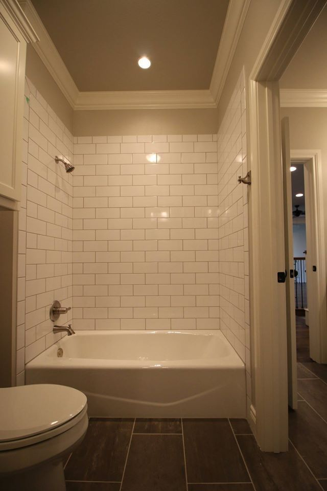 Jack and Jill Bath. Subway Tile Surround, molding and lighting ...