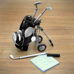 The cutest way to caddy across your desk, this sporty golf pens set is the perfect way to putt notes, nine-iron signatures, and drive to-do lists. With a fully functional, miniature golf bag and three different club ballpoint pens, this lighthearted golf gift is perfect for the golfer who's head is always in the game. Golf Pens with golf bag holder, 4-piece set includes three golf pens with red, blue, and black ink and a miniature pen holder golf bag.