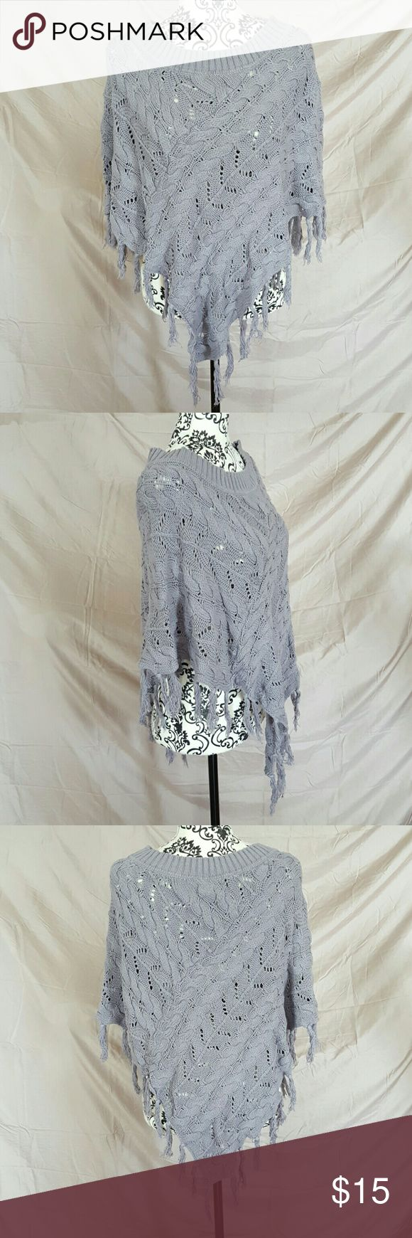 Grey Crochet Festival Poncho Never worn. It's just been sitting in my closet for years. It is a size L/XL. It is a light grey crochet knit with fringe on the bottom. Pointed hem in the back and front. Mudd Tops Tunics