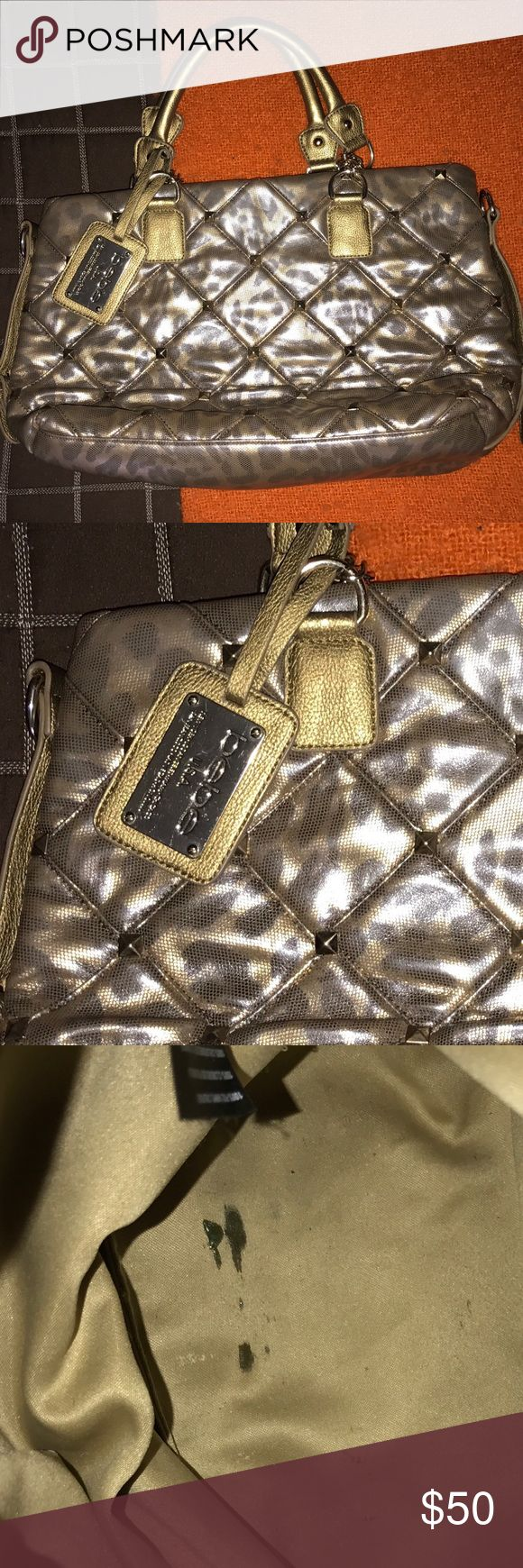 Bebe Purse Beautiful Bebe purse. The rustic gold and silver colors makes it stunning and perfect for any outfit. Purse is in awesome excellent worn condition. The only sign of wear is on the inside (pen mark in the last pic). Offers welcomed😉 bebe Bags Totes