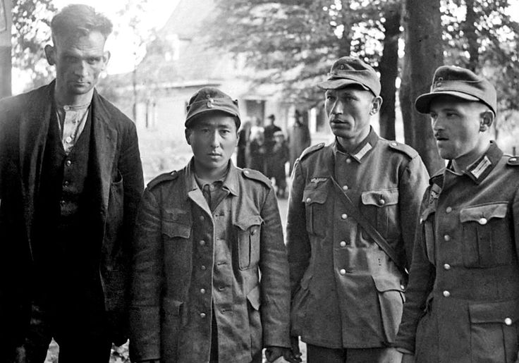 Foreign volunteersof the German Wehrmacht are taken as POWs by British forcesduring the Battle of Arnhem, among them (from left to right): a Dutch collaborator and member of the National Socialist Movement in the Netherlands, a Kazakh volunteer of the 363rd Volksgrenadier Division, and two Polish Wehrmacht soldiers. The Battle of Arnhem was part of the larger, unsuccessful Operation Market Garden foughtbetween 17 and 25 September 1944; an unsuccessfulAllied military operation to force an…