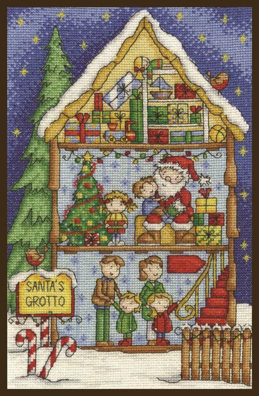 """""""Gruta de Santa""""          DMC presenta este hermoso diseño para Navidad, una imagen de la gruta de Santa mostrando un ático lleno de regalos. El kit contiene aída blanca 14ct, hilo DMC de algodón, diagrama e instrucciones. Dimensiones aprox. 28 x 17,8 cm"""