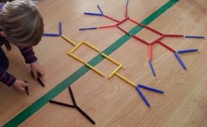 Build a simple structure on one side and have your child copy it on the other side.