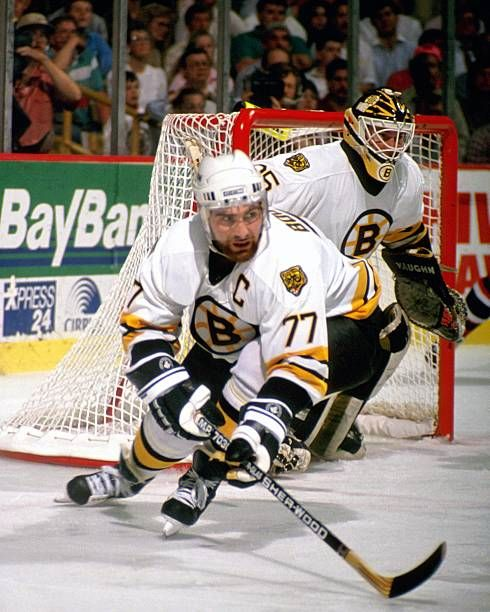 BOSTON MA 1990's Ray Bourque and Andy Moog of the Boston Bruins defend goal in game at the Boston Garden