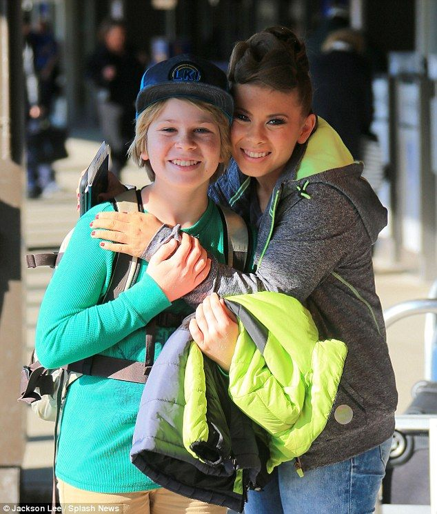 Lookalike siblings: Bindi Irwin cuddld up to her younger brother Robert as she and her family prepared to head home from New Yprk City on Wednesday, following rousing Dancing With The Stars win