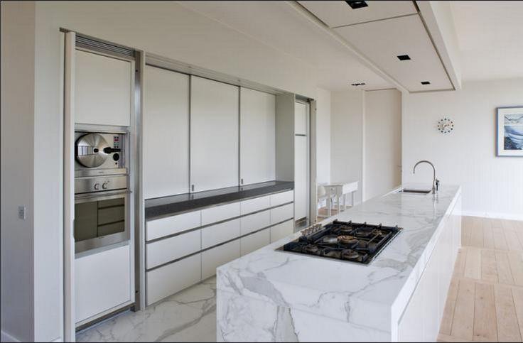 Minimalist kitchen with hidden working area