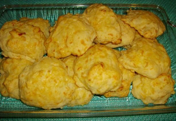 Dixie Stampede Garlic-Cheese Biscuits.  5T butter, melted 1 garlic clove, minced 2C baking mix 2/3C whole milk 2/3C shredded cheddar  bake @450  10min