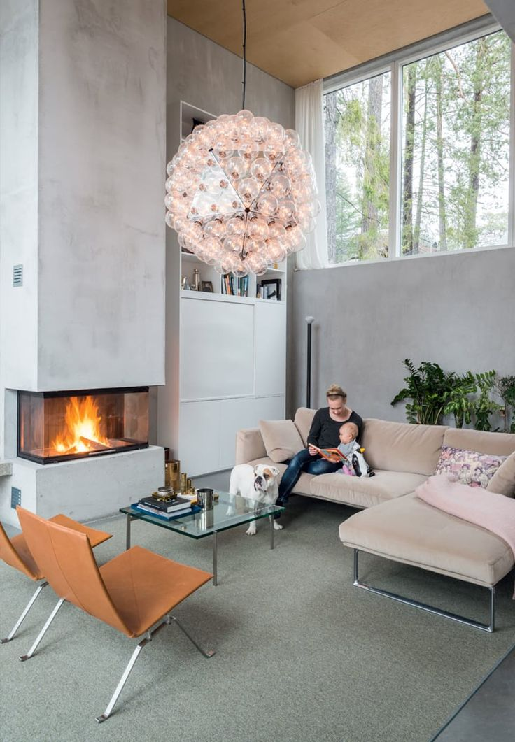 This modern built in fireplace is like a sculptural element in the living room.
