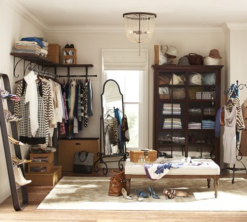 I'll just turn my bedroom into a walk-in closet!  Curtains attached to the shelf part, covering the hanging clothes could make it prettier.