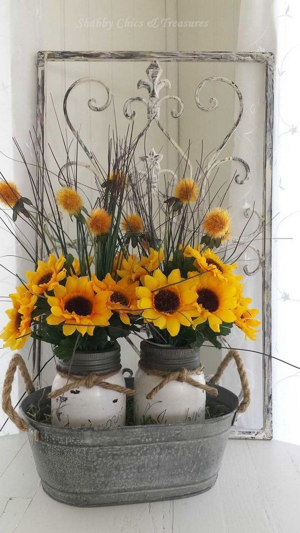 Sunflower Mason Jar Centerpieces. Paint two mason jars in white and lightly distressed and decorated with felt sunflowers with twine tied around the rim of the jar, then put them in a an old bucket.