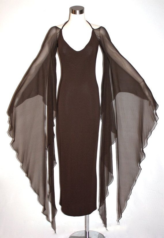 Gorgeous brown jersey and silk chiffon Halston maxi dress with a built in bra, an open back halter neckline, long chiffon angel sleeves and a wiggle