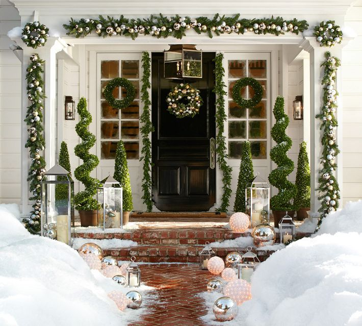 Garlands everywhere. Love the short windows on each side of door instead of sidelights