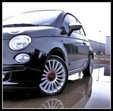 Black FIAT 500 Lounge with premium wheels