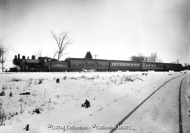 Location: Ottawa, Hurdman, ON  Railway Name: CANADA ATLANTIC RAILWAY CO.  Date: 1893-10-00  Caption: Canada Atlantic passenger train in the vicinity of Hurdman in October 1893.