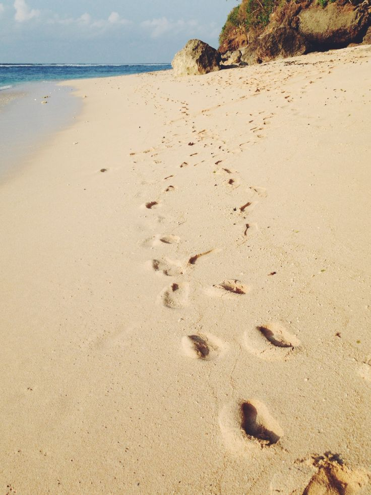 Foot prints in the sand at Green Bowl Beach, Bali