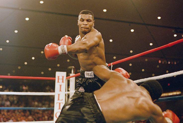 The fighter Mike Tyson knocks down Trevor Berbick on November 22, 1986. It took Tyson two rounds to become, at age 20, the youngest heavyweight champion ever.