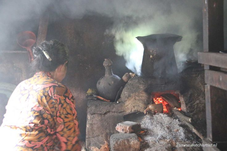 Balinese old woman make cocunut oil .