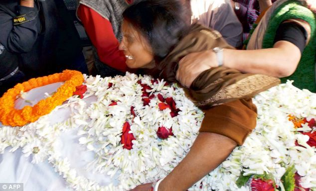 Tragedy: The mother of the 16-year-old rape victim who was burned alive following a series of threats from the perpetrators cries over the teen's body on Wednesday... The girl, 16, was gang-raped in October in Madhyamgram, near Calcutta, by a group of six men - who are believed to have links with West Bengal's ruling party, the Trinamool Congress.Read…