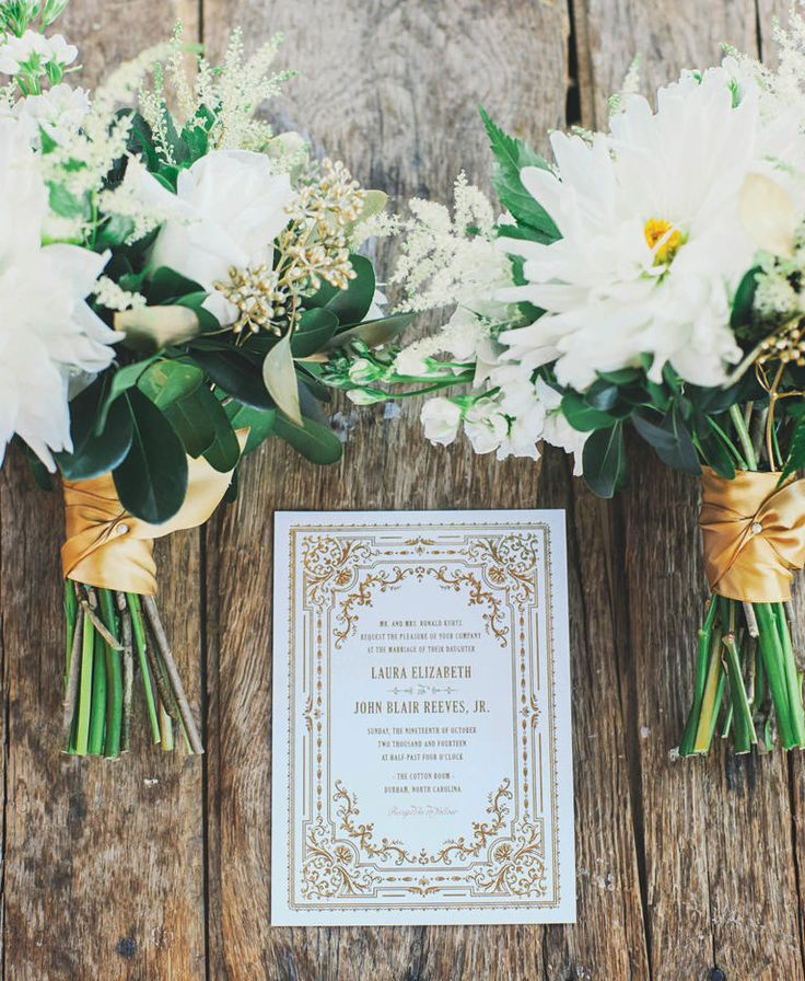 White and gold vintage-themed wedding stationary