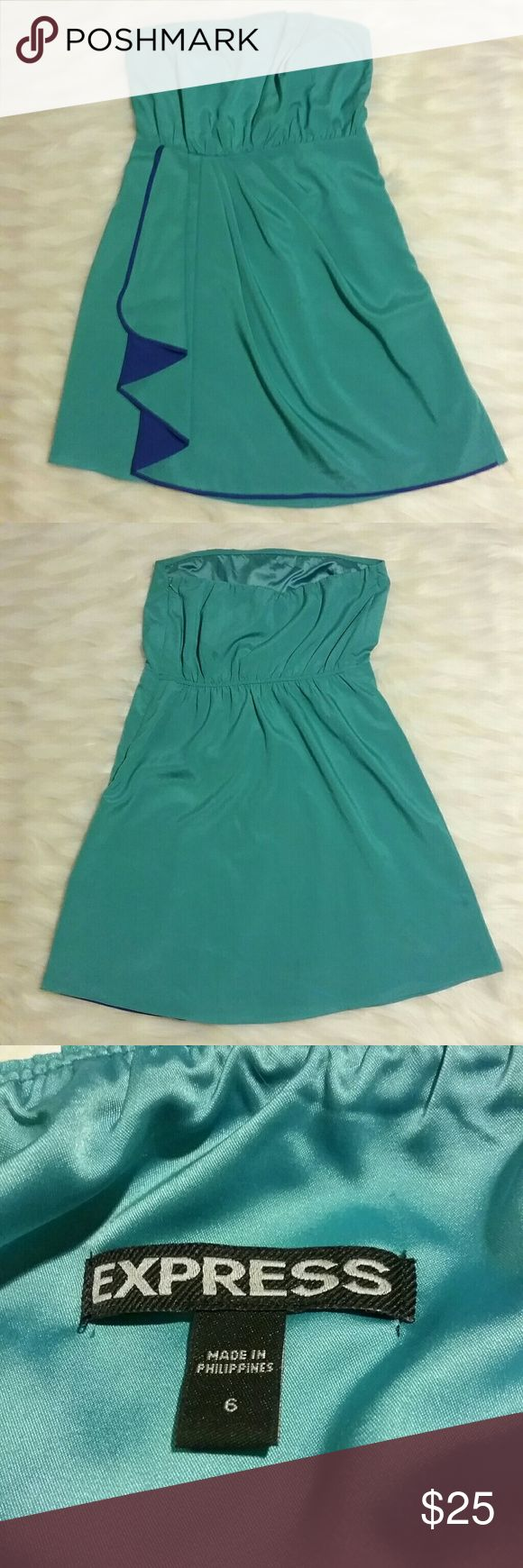 Express Semi-formal dress Beautiful, strapless Semi-formal green (& blue) dress. Excellent condition. Width at top of dress: 15 inches Length: 27 inches Express Dresses