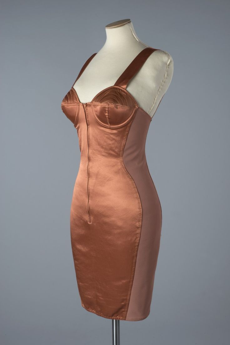 Salmon pink stretch satin corset dress by Jean Paul Gaultier, c.1988. Photograph by John Chase.