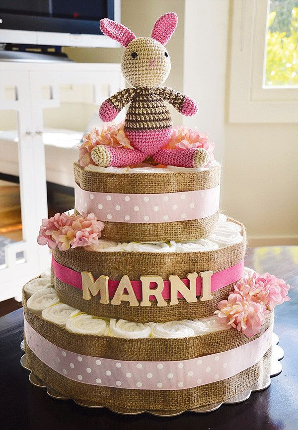 A prepurchased handknit bunny served as the centerpiece of this sophisticated, French-inspired diaper cake.