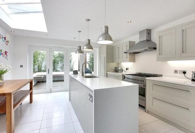 Simple and tasteful kitchen with lovely timber bi-fold doors leading to patio. Tunbridge Wells, Kent