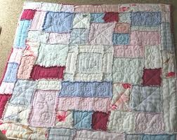 Quilt made from linen shirts, pants and dresses. would love to do this
