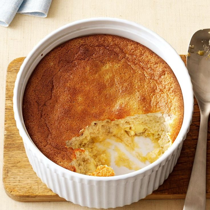 """Banana Souffle Recipe -This pretty, golden-topped puff is so easy to whip up, but looks like you really fussed. Lightly laced with rum, the moist, tender, banana-rich souffle makes that perfect """"little something"""" to wrap up any holiday dinner. —Crystal Jo Bruns, Iliff, Colorado"""
