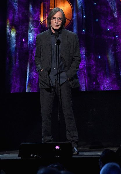 Jackson Browne Photos Photos - Presenter, musician Jackson Browne speaks onstage at the 32nd Annual Rock