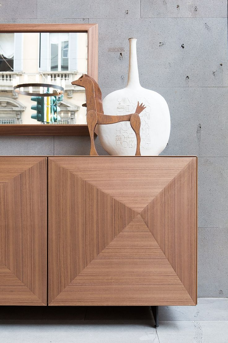 Sideboard CUBRIC WOOD: wooden sideboard with doors top and sides with 45 degrees edges. Doors and sides folded in diamond shape and top in american walnut or coke oak. Internal in american walnut.