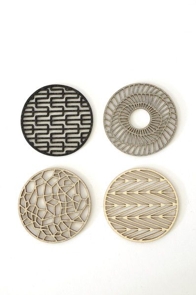 Geometric Coasters - I'm picturing the bottom right as a jelly roll quilt with appliqué triangles