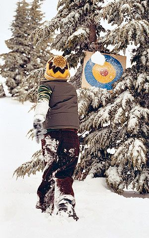 Practice Your Pitch - Paint a bull's-eye target on a piece of cardboard, giving each colored ring a point value. Attach it to a tree, and keep score as the kids try to hit the target with snowballs.