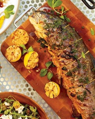 A whole grilled fish impresses with minimal effort: Brush a cleaned, whole arctic char (it tastes similar to salmon) with mint-chive butter and grill for just 20 minutes. Present on a platter with charred lemons and get ready for compliments.
