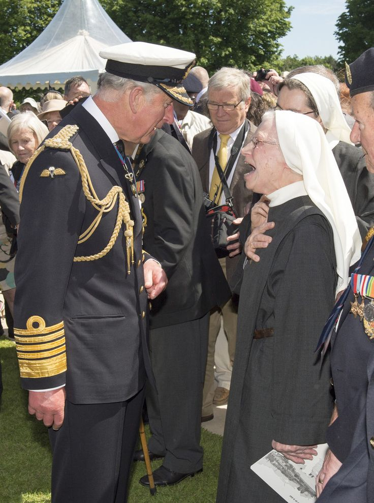 Prince Charles, Prince of Wales meets with nuns at Bayeux Cemetary during D-Day 70 Commemorations on June 6, 2014