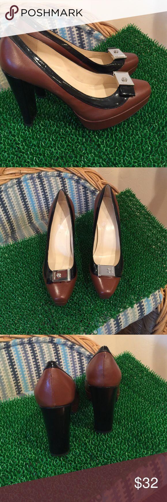 "Calvin Klein Pumps Brown and Black with Silver Calvin Klein Pumps never used, 4"" heels 3/4"" platform, so pretty Calvin Klein Shoes Heels"