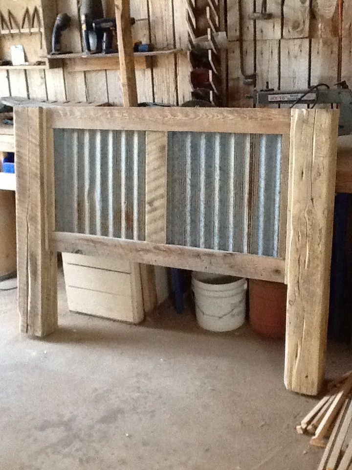 A rustic bed frame with rusted corrugated tin as the inset. No plans but pretty simple design.