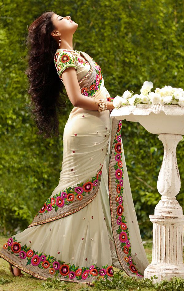 Cream Color Georgatte Designer Saree with blouse. Saree is crafted with Resham,Sequins And patch work . Fabric -Georgatte.