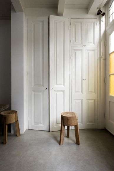 White closet doors, wooden stools
