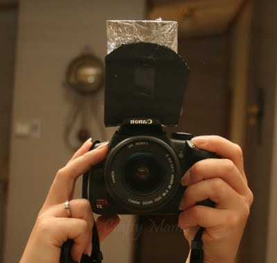 DIY light scoop. For those of us who, you know, have no money for frivolous photog stuff.