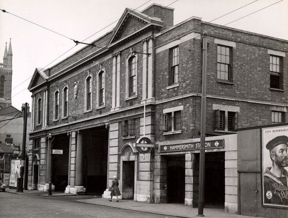 1955 Exterior of Riverside Garage, Hammersmith with the adjacent entrance to the District and Piccadilly line station.