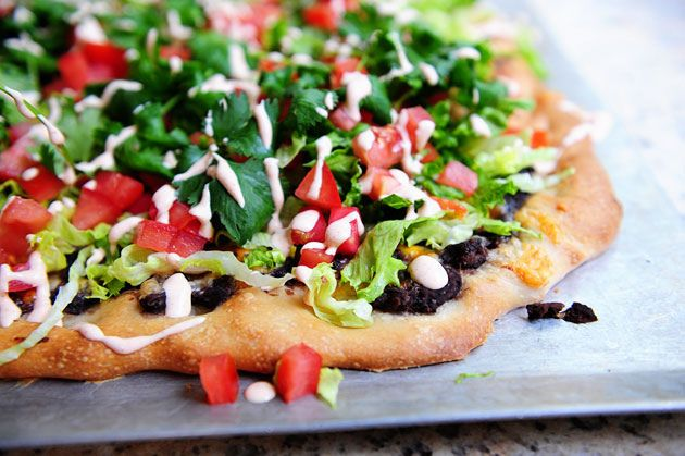 Black bean taco pizza.  This is amazing.  I don't make my own crust just use flat bread and I don't do the strips on top.  Makes it very simple.