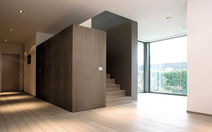 Custom made staircase plus closets by Marc Corbiau, made by Belgian company WILFRA.