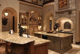 Mediterranean Kitchen with Complex granite counters, High ceiling, Custom hood, Glass panel, Raised panel, L-shaped