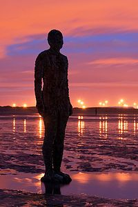 Another Place where 100 cast iron figures face out to sea on Crosby Beach nr Liverpool, England by Antony Gormley