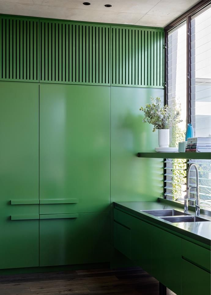 Kitchen is painted in a forest green to link it with the outdoors.