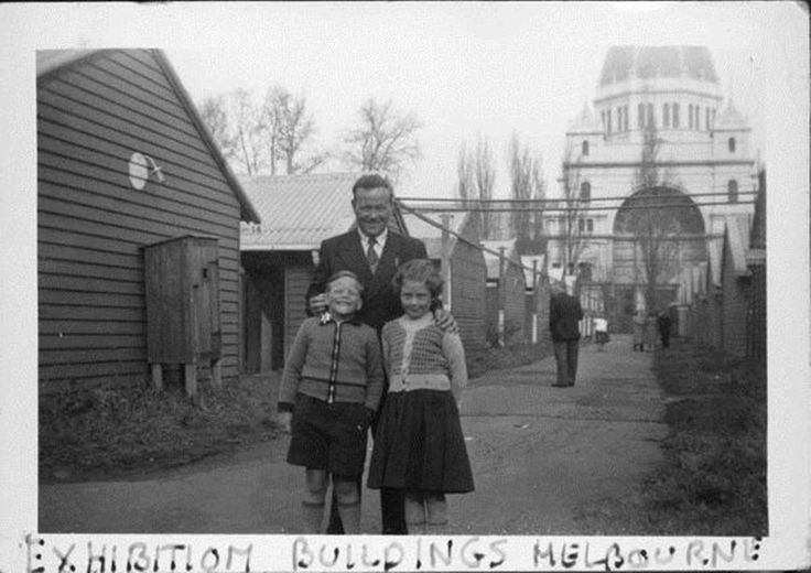George Foster with his two children, June and Brian, at the Migrant Reception Centre at the Royal Exhibition Building. Melbourne. The Foster family migrated from England to Australia in 1955.