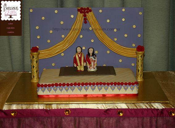 Indian Wedding Cake Design - adaptation of the actual stage with handmade figurines - http://www.preciousgemscakes.com.au